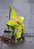Worker or Street Sweeper Cleaning Sewer Opening — Stock Photo