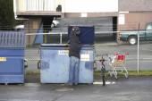 Homeless Man Searches Bin — Stock Photo