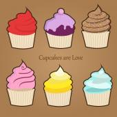 Set of six cute colorful stylized cupcakes with frosting, icing and sprinkles — Stockvektor