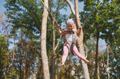 Little girl jumping on trampoline — Stock Photo