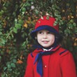 Little girl in red hat and coat — Stock Photo #64763313