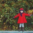 Little girl in red hat and coat — Stock Photo #64763709