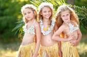 Portrait of three girls in a tropical style — Stock Photo