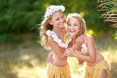 Portrait of two sisters twins in tropical style — Stock Photo