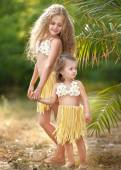 Portrait of two sisters in tropical style — Stock Photo