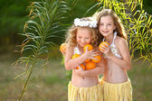 Portrait of two girl in tropical style — Stock Photo