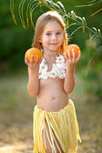 Portrait of little girl in tropical style — Stock Photo