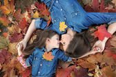 Portrait of mother and daughter in the autumn — Stock Photo