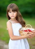 Portrait of a beautiful little girl with raspberries — Stock Photo