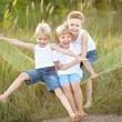 Three children playing on meadow in summer — Stock Photo #60515059