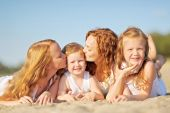 Family portrait of mother and of a boy and his two sisters loved — Stock Photo