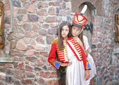 Portrait of two girls in the style of hussars — Stock Photo