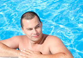 Young man in the swimming pool  — Stock Photo