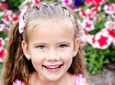 Portrait of adorable happy  little girl in the park — Stock Photo