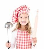 Bambina nel cappello cuoco con mestolo e mattarello — Foto Stock