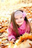 Autumn portrait of cute smiling little girl — Stock Photo
