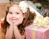 Adorable smiling  little girl lying on floor — Stock Photo