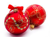 Two red christmas balls with ribbon isolated — Stock Photo