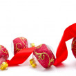 Red christmas balls with ribbon isolated on a white — Stock Photo #57146355
