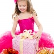 Surprised adorable little girl with christmas gift boxes — Stock Photo #57719885