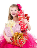 Happy adorable little girl with christmas gift boxes — Stockfoto