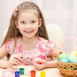 Cute little girl painting colorful easter eggs — Stock Photo #64671689