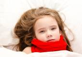 Sick little girl lying in the bed — Stock Photo