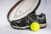 Racket, tennis shoes and a ball — Stock Photo