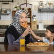 Mother And Daughter Eating Pizza — Stock Photo #69630099
