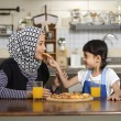 Mother And Daughter Eating Pizza — Stock Photo #69630125