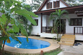 Paradise house with a swimming pool in the tropics — Stok fotoğraf