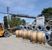 View of the storage of steel coils with loader — Stock Photo