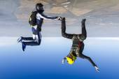 Girl and a guy skydivers in free fall. — Stock Photo
