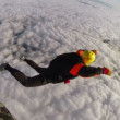 Skydiver simulates the opening of the parachute — Stock Video #77887226
