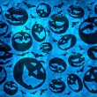 Happy halloween pumpkins with bats on blue background wallpaper — Stock Photo #54454897