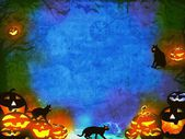 Halloween pumpkins and black cats - blue orange texture — Stock Photo