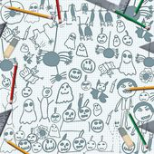 Scribbles of halloween monsters on desk with pencils — Stock Photo