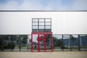 Office building with red entrance — Stock Photo
