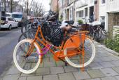 Orange bicycle — Stock Photo