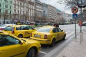 Yellow taxis in prague — Stock Photo