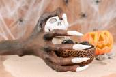 Halloween witch hand and pumpkin ornament close up — Stock Photo