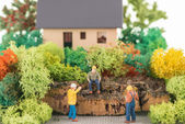 Miniature workers getting ready to renovate the house — Stock Photo