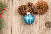 Christmas baubles and pine cones — Stock Photo