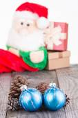 Christmas baubles and Santa Claus toy close-up — Stock Photo