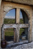 Sky and field landscape reflected in old wood window — Stock Photo