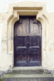 Old wood door with metal knob in Prejmer fortified church, Brasov county, Romania — Stock Photo