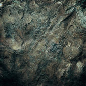 Stone wall texture grunge background and black vignette — Stock Photo