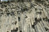 Basalt wall near the road — Stock Photo