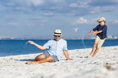 Happy father and his son having fun at the beach — Stock Photo