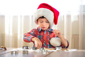 Little boy baking cookies, Merry Christmas — Стоковое фото